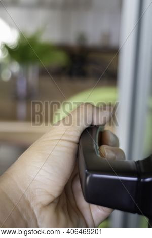Woman Hand Holding The Door Bar To Open The Door, Stock Photo