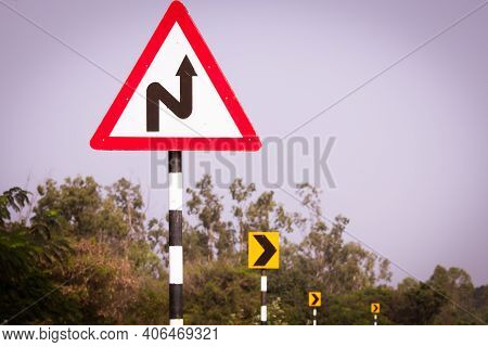 Indian Road Cautionary Sign Indicating Right Reverse Bend Ahead. Sign Indicating Right Reverse Bend.