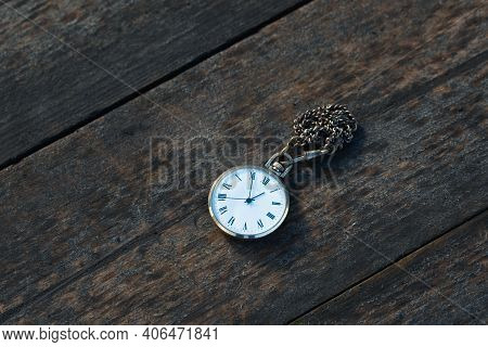 Old Pocket Watch On Wooden Background Close Up