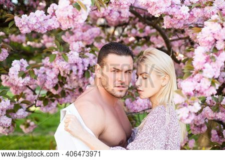 Spring Romantic Couple In Love Looking At Each Other. Passionate With Naked Torso. Sensual Couple In