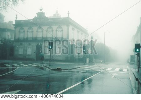 View of the buildings on deserted foggy street in Porto, Portugal.