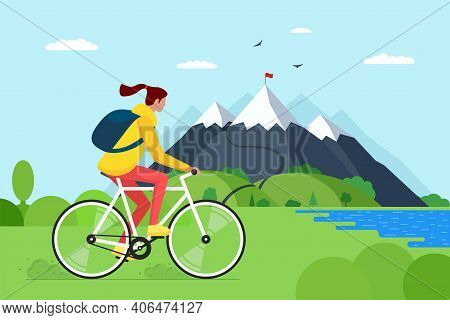Young Woman Riding Bicycle In Mountains. Girl Bicyclist Tourist With Backpack On Bike Travel In Natu