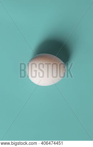 Easter Concept. White Egg On A Green Background In Pastel Colors. The Chicken Laid The Egg. Natural