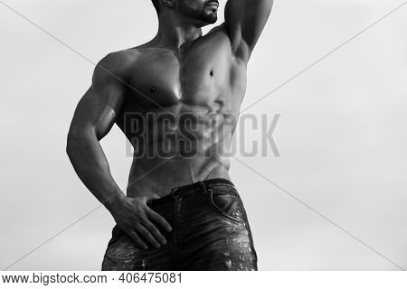 Muscular And Sexy Torso Of Young Man Having Perfect Athletic Body. Sexy Man With Muscular Body On Bl