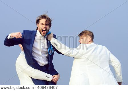Business Man Fighting. Group Of Business People Fighting On Blue Sky Background, Conflict