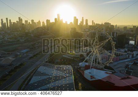 Melbourne, Australia - Jan 24, 2021: Aerial Photo Of Ferris Wheel And Melbourne Cbd At Sunrise