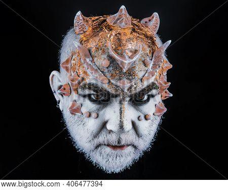 Head With Thorns, Close Up. Demon, Sorcerer Makeup. Fantasy Concept. Demon On Serious Face, Black Ba