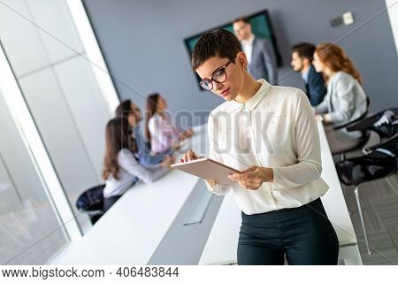 Portrait Of A Confident Business Woman With Digital Tablet In Office