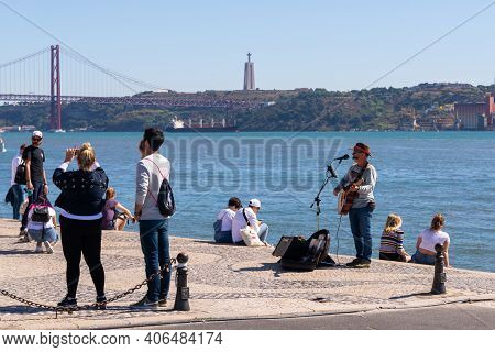 Portugal, Lisbon, October 08, 2018: Street Musician Playing Electric Guitar On The Waterfront. Befor