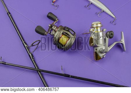 Fishing Rod Fly Fishing Reel, Baitcasting Reel And Baits On Blue Background. Fishing, Tackle, Sport.