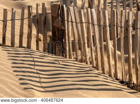 Fencing To Prevent The Erosion Of Sand Dunes At Camber Sands, East Sussex, Uk