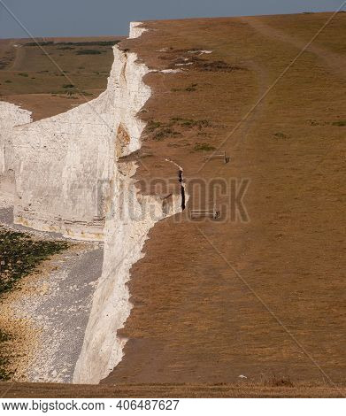 A Crack In The Cliff Top At Seven Sisters Prior To A Cliff Fall Near Birling Gap, Sussex, Uk