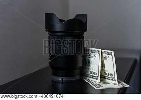 Making Money On Photography. Photographers Income. Money Camera. Concept Money Lens