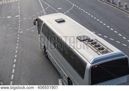 Big Tourist Bus Rides On A Multi-lane Highway