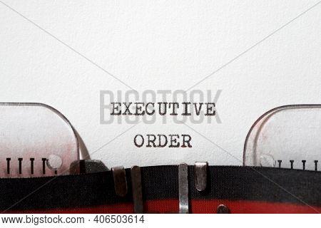 Executive order phrase written with a typewriter.