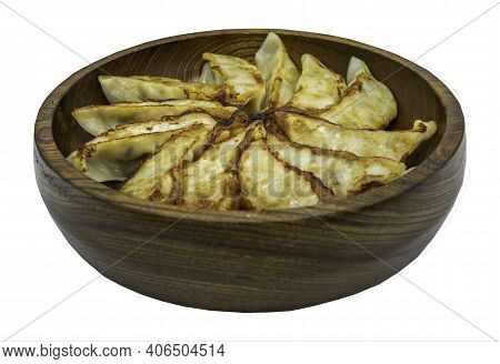 Asian Dinner : Fried Japanese Gyoza Dumplings On Wooden Bowl Isolated On White Background With Clipp