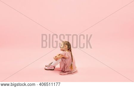 Sitting, Dreaming. Childhood And Dream About Big And Famous Future. Pretty Longhair Girl On Coral Pi