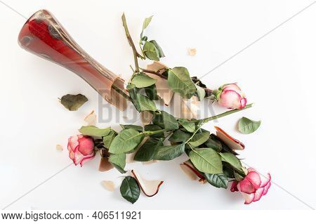Broken Glass Vase. Broken Vase Of Flowers. Broken Vase Of Roses On The Floor.