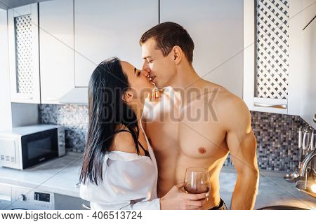 Celebrating Valentine's Day. Loving Heterosexual Couple With Beautiful Naked Figures And Bodies Hug,