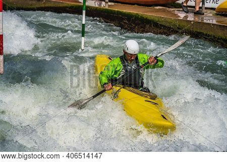 Augsburg, Germany - June 16, 2019: Whitewater Kayaking, Extreme Kayaking. A Guy In A Kayak Sails On