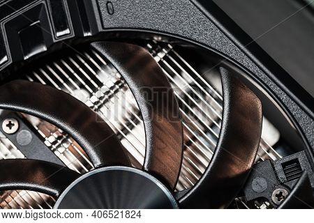 New Shiny Black Gpu Cooler Fragment, Close-up Photo. This Fan Is Mounted On A Video Card To Cool The