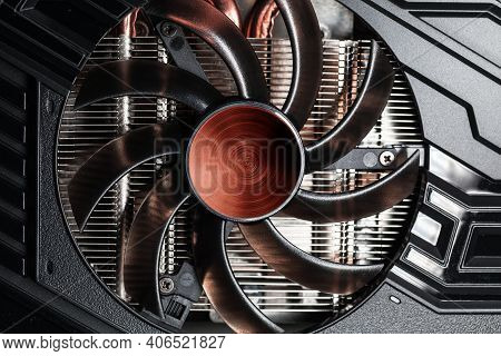 New Shiny Black Gpu Cooler With Red Center, Close-up Photo. This Fan Is Mounted On A Video Card To C