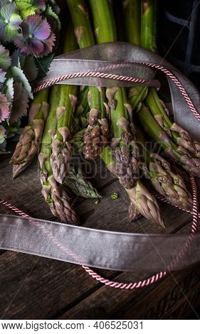 Stylishly Presented Green Asparagus With Hydrangeas Flowers. Still Life In Vintage Style With Health