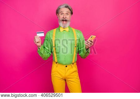 Photo Of Funky Aged Grey Haired Grandpa Hold Telephone Use Credit Card Online Payment Wear Green Shi
