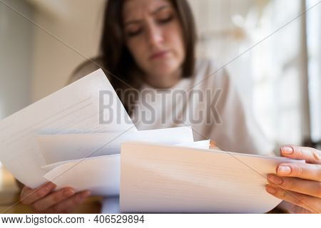 The Manager Cant Handle The Workload. A Lot Of Documents And Accounts In The Womans Hands Close Up