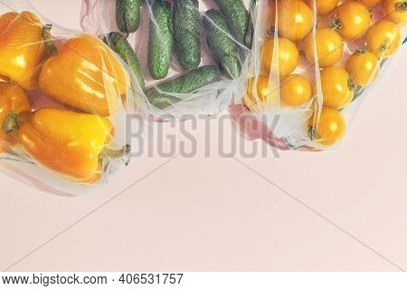 Reusable Packaging Of Products By Weight. Bell Peppers, Cucumbers And Tomatoes In A Reusable Bag On