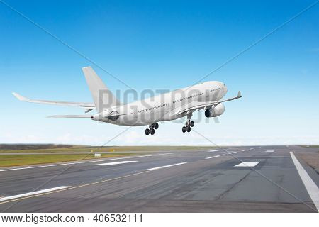 Aircraft Landing On The Runway, Flight Before Touching The Asphalt, Rear View To The Runway End