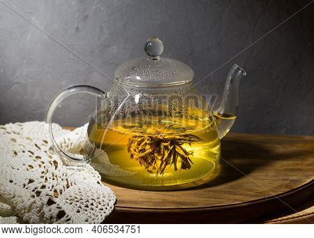 Japanese Green Tea And Glass Teapot. Green Tea In Pot On Gray Background. Teapot Of Green Herb On Wo