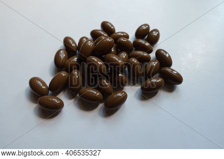 Closeup Of Heap Of Brown Softgel Capsules Of Vitamin D3
