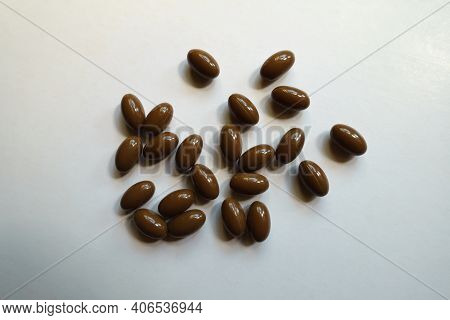 Numerous Brown Softgel Capsules Of Vitamin D3 From Above