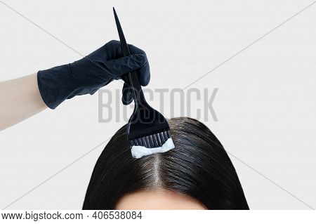 Dyeing Gray Hair. Brush In Hand With Paint Dyes Black Hair. White Background.