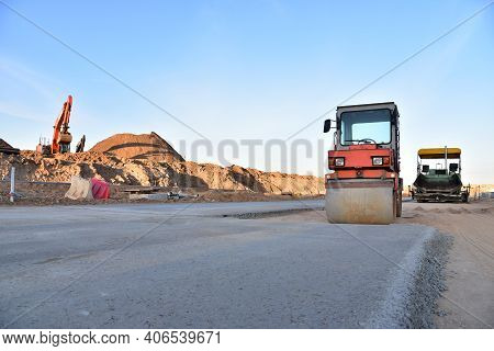 Asphalt Paver Machine During Road Work. Road Machinery At Construction Site For Paving Works. Screed