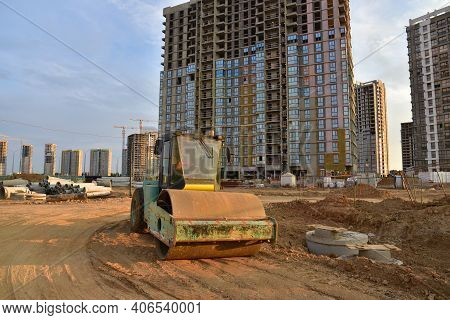 Vibro Roller Soil Compactor Leveling Ground At Construction Site. Vibration Single-cylinder Road Rol