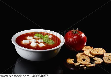Tomato Soup. Homemade Tomato Soup With Mozzarella Pieces, Tomatoes, Herbs, And Fresh Basil. With Toa