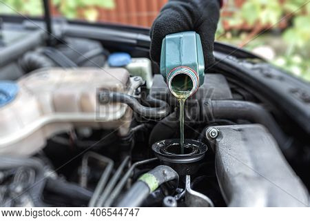 Repair Of An Old Car. Filling Engine Oil.