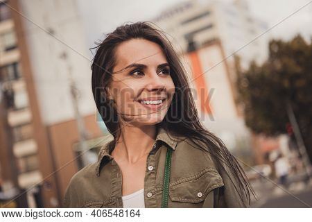 Photo Of Cute Shiny Charming Sweet Young Lady Wear Brown Shirt Smiling Walking Looking Side Outside