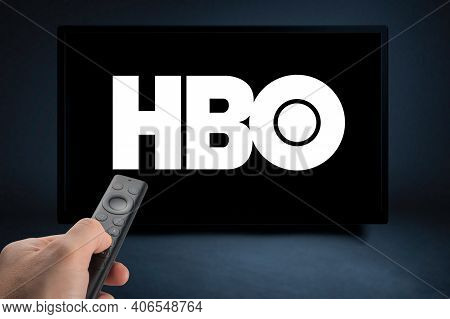 Usa, New York February 2, 2021: Close Up Of Nvidia Sheild Tv Remote In Hand And Tv Screen With Hbo L