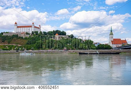 Bratislava, Slovakia - July 9, 2019: The Bratislava Castle And  The St. Martin Cathedral Seen From T