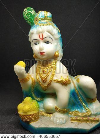 Idol Of God Sri Krishna The Indian Hindu Religious God Selectively Focused With Black Background.