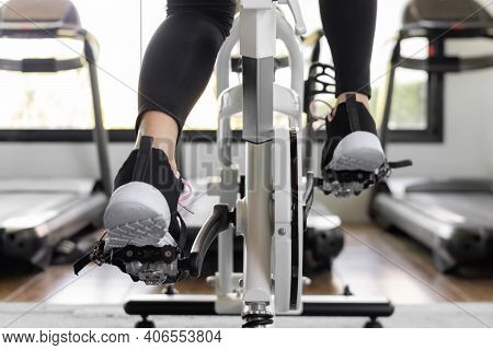 Close Up Foot Biking In Gym, Exercising Legs Doing Cardio Workout Cycling Bikes