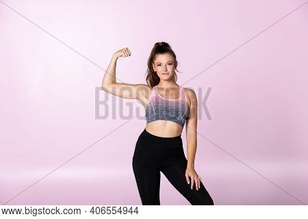 Strong Female Fit Woman Shows Biceps And Flex Muscels, Trainer Finished Workout, Sporty Girl Has Ach