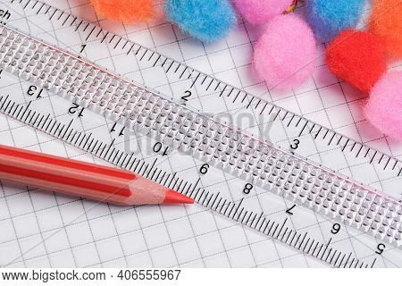 On An Open Tear-off Notepad For Notes, Checkered Sheets, A Transparent Ruler With A Red Pencil Lies