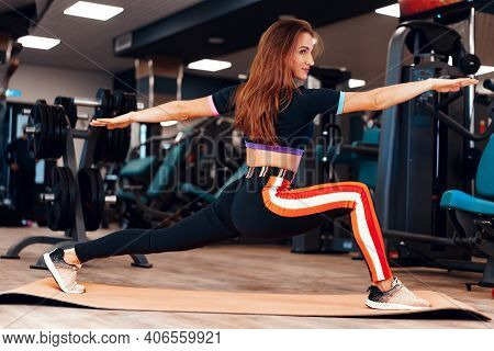 Fit Girl Doing Stretching Exercies For Legs