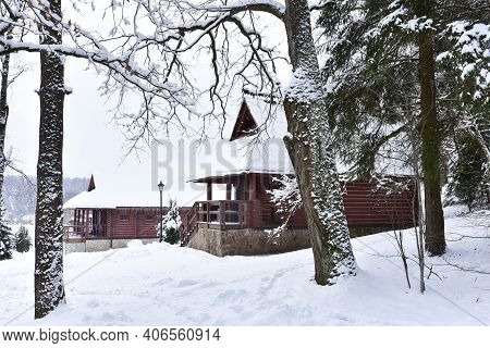 Wooden House In Forest In Winter Time. Log Cabin In The Forest Alone In Wilderness. Wooden Houses Wi