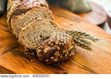Homemade Sourdough Bread With Fenugreek, Sesame Seeds, Pumpkin Seeds And Flax Seeds On A Wooden Boar