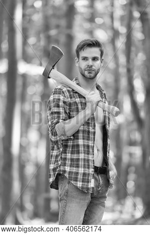 Rugged Look. Unshaven Man Carry Axe In Woods. Lumberjack Style. Axeman Wear Open Plaid Shirt With Je